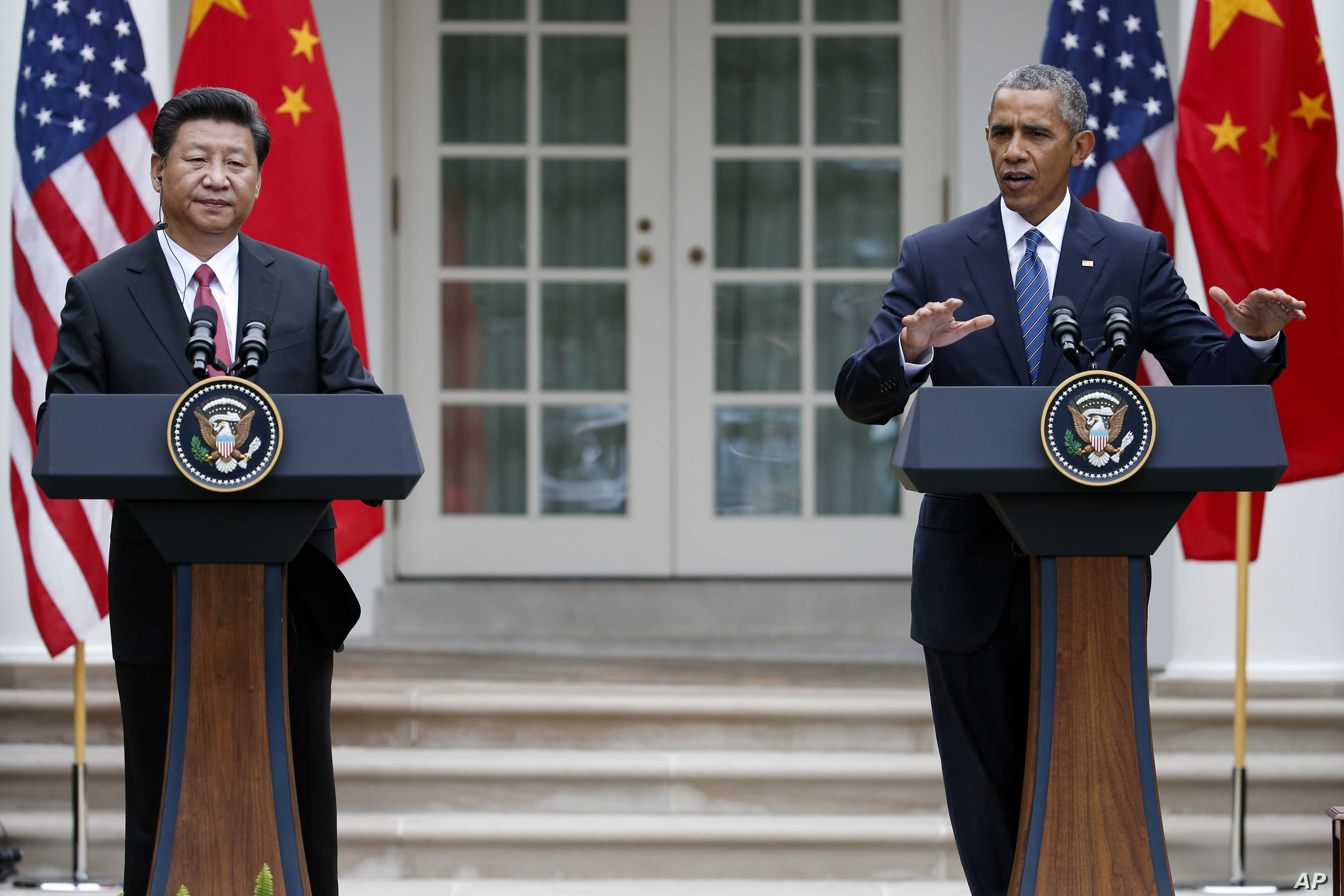 President Barack Obama gestures during a joint news conference with Chinese President Xi Jinping, Sept. 25, 2015, in the Rose Garden of the White House in Washington.