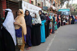 Women stand in a line at a voting center to cast their ballot during the general election in Dhaka, Bangladesh, Dec. 30, 2018.