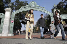 FILE - In this Dec. 14, 2011, photo, University of California Berkeley students walk through Sather Gate on the campus in Berkeley, California.