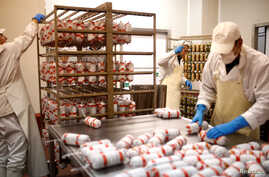 Workers make salami at Akova Impex Meat Industry Ovako, which makes halal quality certified products, in Sarajevo, Bosnia and Herzegovina, Dec. 2, 2016.