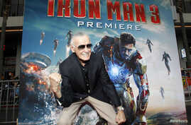 "Stan Lee gestures as he poses at the premiere of ""Iron Man 3"" at El Capitan theater in Hollywood, California, April 24, 2013."