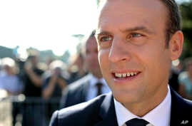 French President Emmanuel Macron meets people after voting in the final round of parliamentary elections, in the northern seaside town of Le Touquet, France, June 18, 2017.