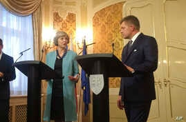 British Prime Minister Theresa May, left, speaks during a joint press briefing with Slovak Prime Minister Robert Fico, right, Bratislava, Slovakia, July 28, 2016.
