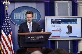 White House press secretary Josh Earnest uses a graphic to discuss the Trans-Pacific Partnership during the daily briefing at the White House in Washington, Oct. 13, 2015.