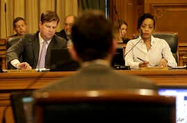 Mark Farrell, left, and Malia Cohen, right, listen as Scott Wiener, foreground, speaks during a San Francisco Board of Supervisors meeting at City Hall in San Francisco, Tuesday, April 5, 2016. San Francisco has approved a measure making it the first