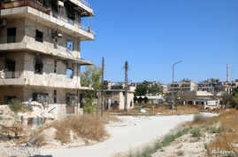 A view shows what is believed to be the road that civilians would have to use to access one of the safe exit points opened for civilians wishing to leave rebel-held areas, in Aleppo's Bustan al-Qasr, Syria July 29, 2016.