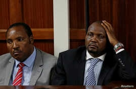 "FILE - Kenyan politicians Ferdinand Waititu and Moses Kuria sit in the dock at the Milimani Law Courts over alleged ""hate speech,"" flagging growing tension in Kenya's capital Nairobi, June 14, 2016."