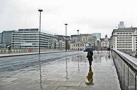 Walking across London Bridge on a rainy, wet day in June 2011
