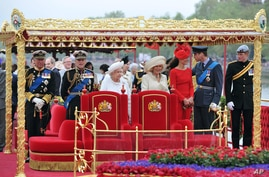 Members of the British Royal family, from left to right, Prince Charles, Prince Philip, Queen Elizabeth II, Camilla Duchess of Cornwall, Kate Duchess of Cambridge, Prince William and Prince Harry on board the royal barge during the Diamond Jubilee Pa...