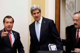U.S. Secretary of State John Kerry (C) is escorted by Rep. Ed Royce (L), chairman of the House Foreign Affairs Committee, and Rep. Eliot Engel (R) before giving testimony on Capitol Hill in Washington, April 17, 2013.