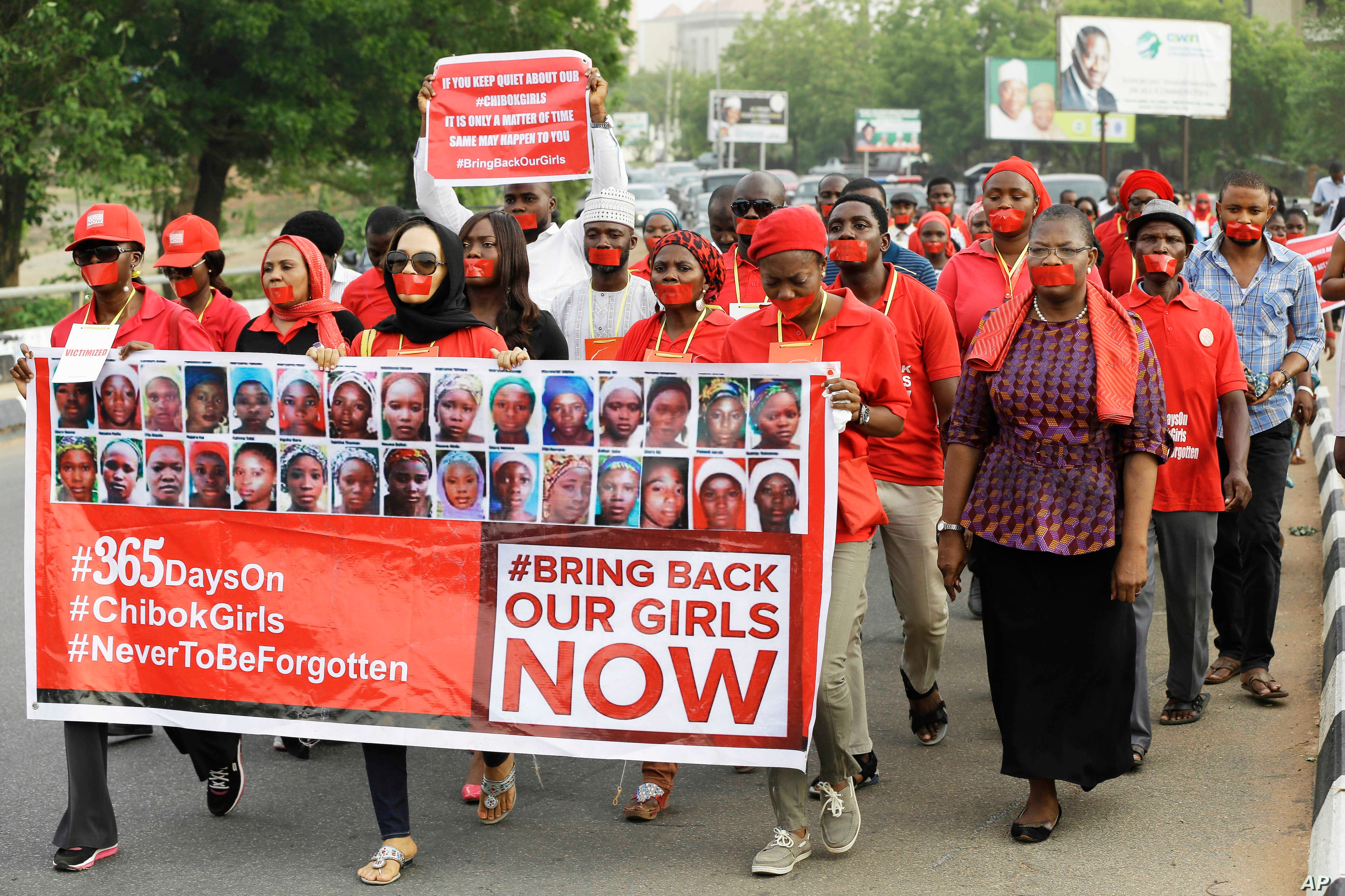 People march in a silent protest calling on the government to rescue the kidnapped girls of the government secondary school in Chibok, who were abducted a year ago, in Abuja, Nigeria, April 13, 2015.