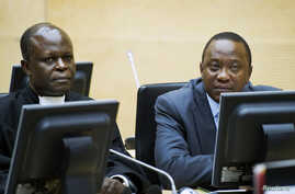 FILE - Kenya's President Uhuru Kenyatta (R) and a member of the Defense Council attend a hearing at the International Criminal Court in The Hague, Netherlands, Sept. 21, 2011.