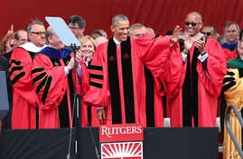 President Barack Obama waves as he arrives to deliver a commencement address at Rutgers graduation ceremonies, May 15, 2016, in Piscataway, N.J.