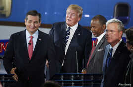 Republican U.S. presidential candidates (L-R) U.S. Senator Ted Cruz, businessman Donald Trump, Dr. Ben Carson and former Florida Governor Jeb Bush take a break during a commercial in the midst of the second official Republican presidential candidates