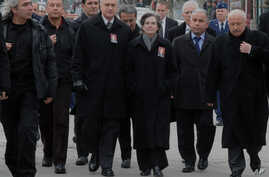 U.S. Ambassador to Turkey, Francis J. Ricciardone, third left, and his wife Marie arrive to attend the funeral ceremony for Mustafa Akarsu, an embassy security guard killed when a suicide bomber struck the American Embassy in Ankara, February 2, 2013