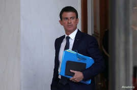 French Prime Minister Manuel Valls leaves the Elysee Palace in Paris, following a cabinet meeting Nov. 9, 2016. Valls supports tariffs on imports from countries that do not implement the Paris Agreement.