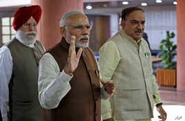 Indian Prime Minister Narendra Modi, center, arrives for a Bharatiya Janata Party (BJP) parliamentary party meeting in New Delhi, India.