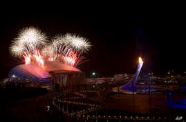 Fireworks explode over Olympic Park during the closing ceremony of the 2014 Winter Olympics, Sunday, Feb. 23, 2014, in Sochi, Russia.