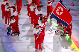 Jong Hyon Kim of North Korea carries the national flag during the opening ceremony, March 9, 2018, in Pyeongchang Olympic Stadium at the Pyeongchang 2018 Winter Paralympics in Pyeongchang, South Korea.