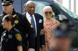 FILE - Bill Cosby arrives with his wife, Camille, right, for his sexual assault trial at the Montgomery County Courthouse in Norristown, Pennsylvania, April 24, 2018.