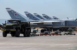 Russian military jets are seen at Hmeymim air base in Syria, June 18, 2016.