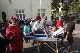 A Zimbabwe opposition member of parliament is rushed to hospital after she collapsed in parliament during the 2018 Budget presentation in Harare, Nov. 22, 2018.