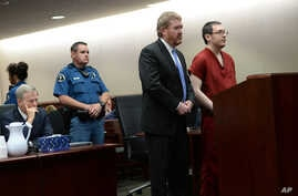 Colorado theater shooter James Holmes (right) appears in court with his attorney Daniel King to be formally sentenced as Prosecutor George Brauchler looks on, in Centennial, Colorado, Aug. 26, 2015.