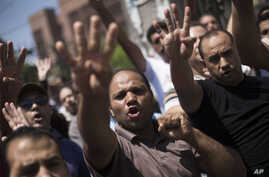 Supporters of Egypt's ousted President Mohammed Morsi chant slogans against the Egyptian Army during a march near Al Nour mosque in Abassia district in Cairo, Egypt, Aug. 23, 2013.