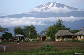 Houses sit at the foot of Mount Kilimanjaro in Tanzania's Hie district.