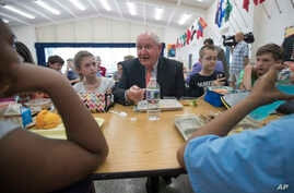 Agriculture Secretary Sonny Perdue eats lunch with students at the Catoctin Elementary School in Leesburg, Virginia, May 1, 2017. Perdue unveiled a new rule on school lunches as the Trump administration and other Republicans press for flexibility aft...