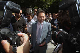 Greece's Finance Minister Yannis Stournaras makes statements after a meeting with Greece's PM Antonis Samaras and the heads of the two junior coalition parties in Athens, Sept. 27, 2012. Stournaras says the heads of the three parties in the governing