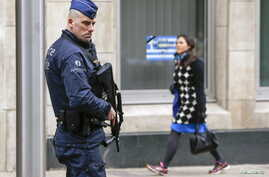 A Belgian police officer secures the area around the European Council headquarters following recent bomb attacks in the Brussels metro and at Belgian international airport of Zaventem, in Brussels, Belgium, March 30, 2016.