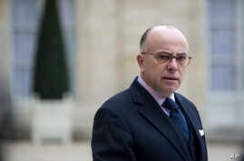 FILE - Then-French Interior minister Bernard Cazeneuve gives a press conference at the Elysee Palace.