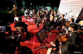 Chief Principal Conductor Karim Wasfi leads the Iraqi National Symphony Orchestra during a concert in Mosul, Oct. 27, 2018.