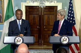 In this screen grab taken from U.S. Department of State, Secretary of State John Kerry (right) and his Nigerian counterpart Geoffrey Onyeama speak to reporters at the State Department in Washington, D.C., March 30, 2016.