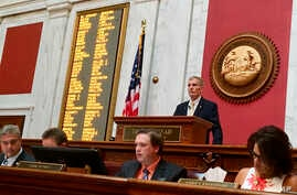 West Virginia House Speaker Pro Tempore John Overington, top, presides over the start of a hearing Monday, Aug. 13, 2018, at the state Capitol in Charleston, W. Va. The House of Delegates is considering the impeachment of the entire state Supreme Cou