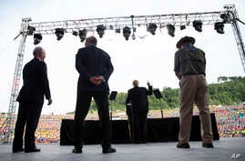 President Donald Trump joined by Secretary of Health and Human Services Tom Price, Secretary of Energy Rick Perry and Interior Secretary Ryan Zinke as he speaks at the 2017 National Scout Jamboree in Glen Jean, W.Va., July 24, 2017.