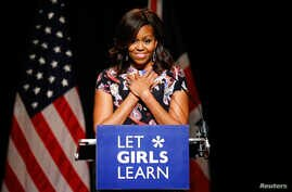 U.S. first lady Michelle Obama speaks to pupils during a visit to Mulberry school for girls in London, Britain, June 16, 2015.