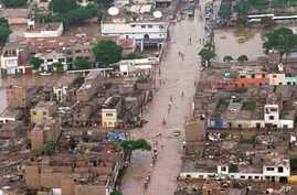 FILE - A panoramic view shows a highway flooded by heavy rains southeast of Lima, Peru, Jan. 30, 1998. This past week, the country has been hit by heat and rain extremes not seen in two decades..