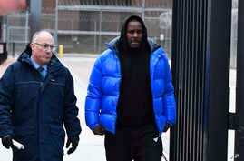 R. Kelly, right, leaves Cook County Jail with his defense attorney, Steve Greenberg, Feb. 25, 2019, in Chicago.