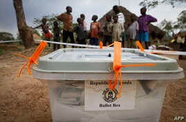 FILE - A closed ballot box waits to be taken to an electoral commission after voting in Buwuno, Uganda, on Feb. 18, 2011.