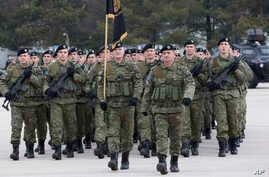 FILE - Members of the Kosovo Security Force (KSF) take part in a ceremony in the Kosovo capital Pristina.