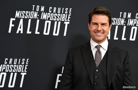 """Actor Tom Cruise poses for photographers as he arrives for the premiere of """"Mission:Impossible-Fallout,"""" at the Smithsonian's National Air and Space Museum, in Washington, July 22, 2018."""