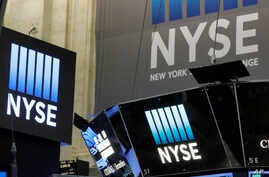 The top of a trading post and an NYSE banner above the trading floor of the New York Stock Exchange are shown, Nov. 10, 2016.