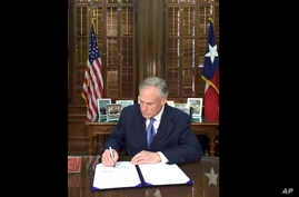 "In this Sunday, May 7, 2017 frame from video posted by the Office of the Governor, Republican Gov. Greg Abbott signs a so-called ""sanctuary cities"" ban in Austin Texas."