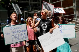 Demonstrators protest outside the Comcast Center in Philadelphia, July 27, 2016, during the third day of the Democratic National Convention.