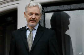 WikiLeaks founder Julian Assange speaks from the balcony of the Ecuadorean Embassy in London, Feb. 5, 2016.