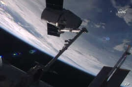In this frame from NASA TV, the SpaceX Dragon capsule arrives at the International Space Station bearing supplies on July 20, 2016.