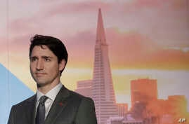 Canada's Prime Minister Justin Trudeau waits to speak at the AppDirect office in San Francisco, Feb. 8, 2018.