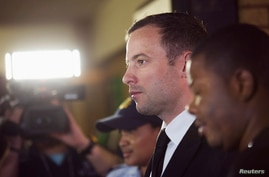 South African Olympic and Paralympic track star Oscar Pistorius arrives at the North Gauteng High Court in Pretoria, September 12, 2014.